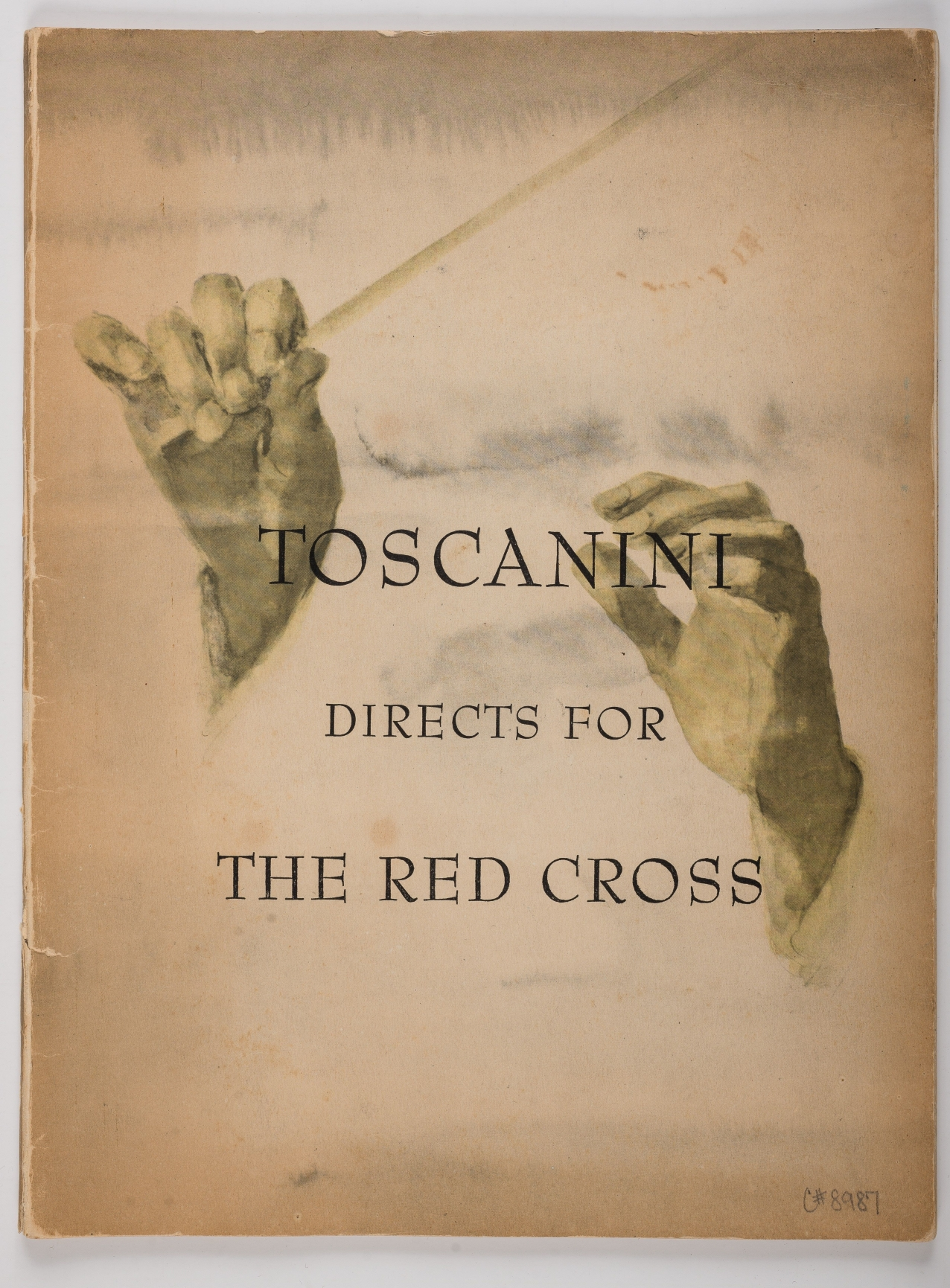 "Program cover illustration of Arturo Toscanini's hands conducting. Text printed ontop of the hands says ""Toscanini directs for the Red Cross""."