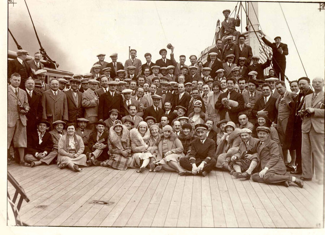 Photo of New York Philharmonic musicians, significant others, and guests aboard the SS De Grasse departing for their first stop in the tour, Paris.