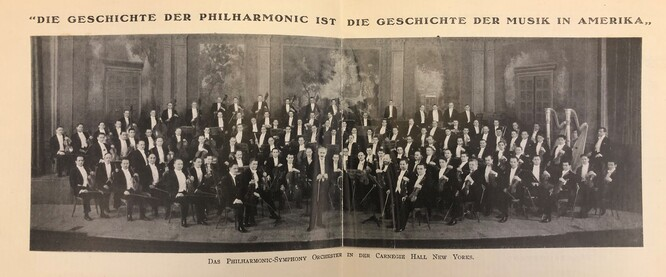 Photograph of the full New York Philharmonic orchestra on stage
