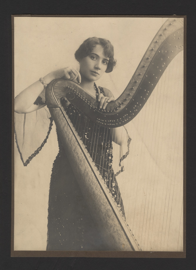Portrait photograph of Steffy Goldner posing with harp