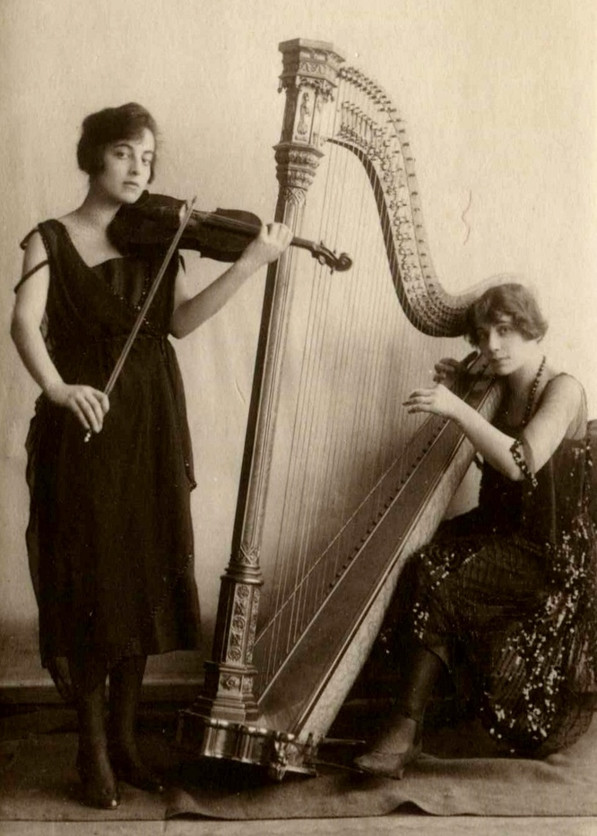 Portrait of Trudy Goldner with violin and Steffy Goldner with harp.