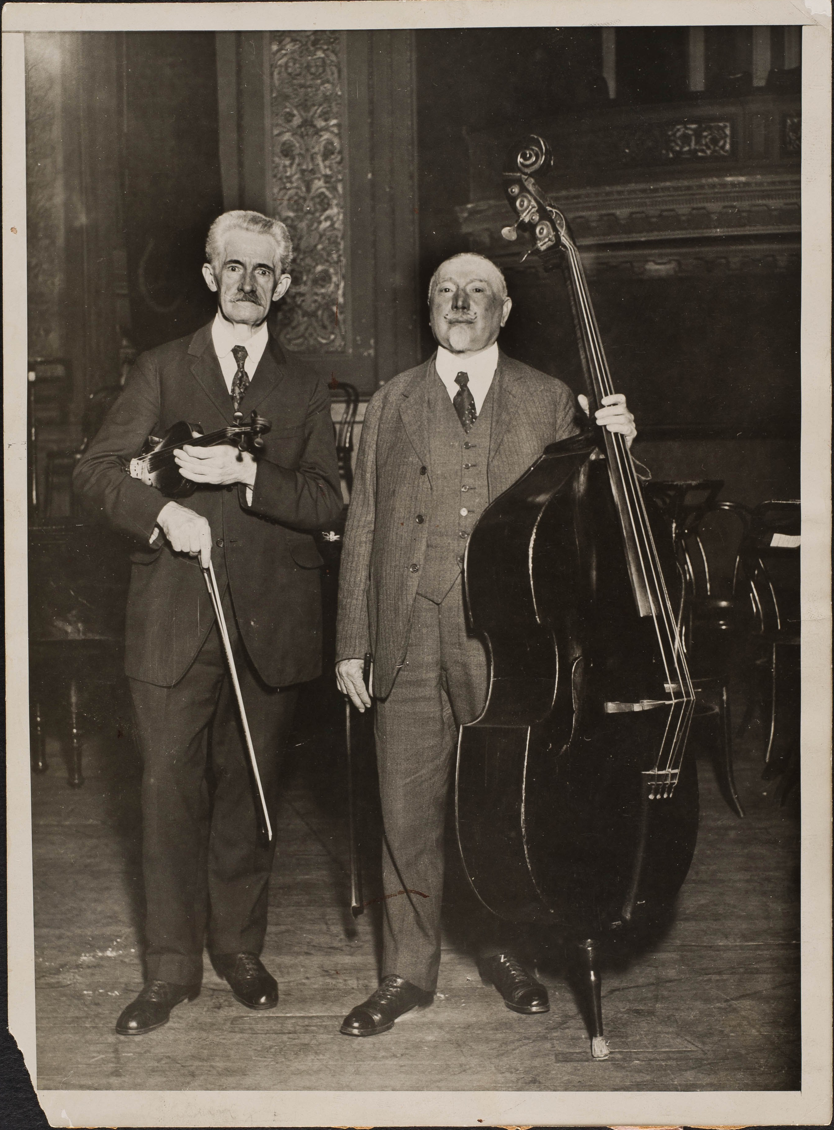 Henry Boewig, Philharmonic Librarian and violinist (1888-1918) with Ludwig Manoly, a member of the Philharmonic bass section (1879-1927)